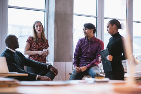 Diverse Business Team Discussing Work In Office